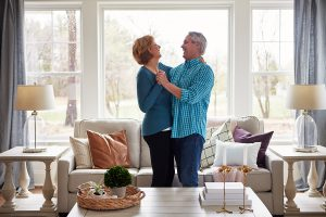 Shot of a happy mature couple dancing together in their living room at home